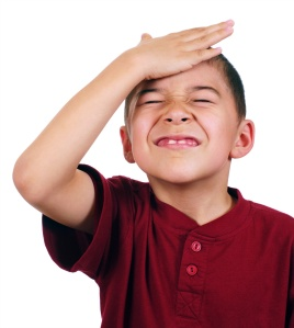Kid slaps himself on head, oh-no, isolated on white